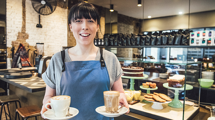 Woman holding coffees