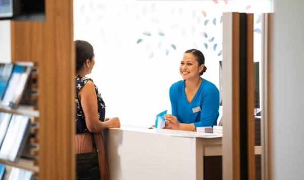 A customer and bank teller in an ANZ branch